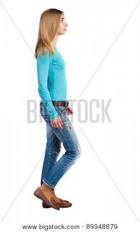 side view of walking  woman in jeans. beautiful blonde girl in motion.  backside view of person.  Rear view people collection. Isolated over white background. Girl in leather shoes is right