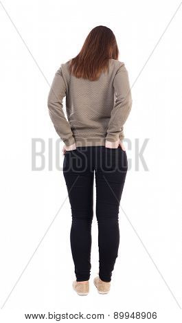 back view of standing young beautiful  woman in jeans. girl  watching. Rear view people collection.  Isolated over white background. She stands with folded hands in the back pockets of his trousers.