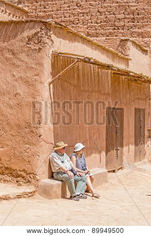 Ait Benhaddou, Morocco: Elderly father with daughter rest in old city