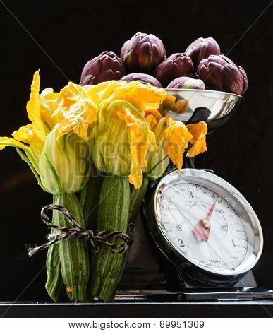 fresh zucchini flowers and artichokes