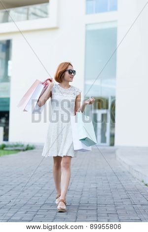 Smiling Girl With Paper Bags