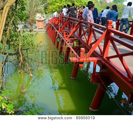 Tourists On The Red Bridge Over Lake Hoan Kiem, Hanoi, Vietnam