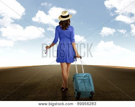 Woman Holding Suitcase Walking On The Road
