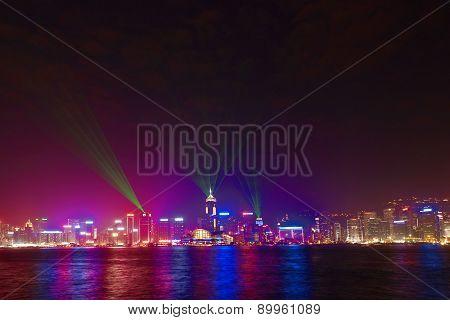 Hong Kong Skyline At Night With Laser Beams