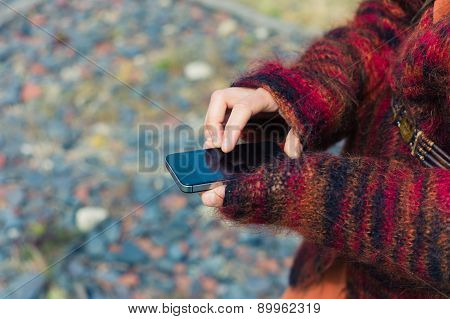 Young Woman Using Smartphone Outside