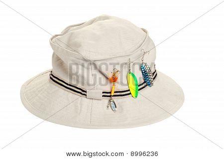 khaki hat with fishing tackle