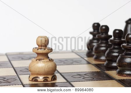 White Pawn Challenging Army Of Black Chess Pieces