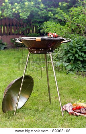 round metal barbecue grill appliance picnic outdoors