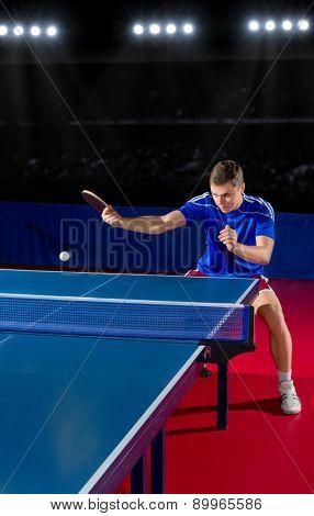 Young table tennis player at sports hall
