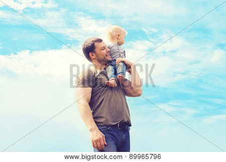 Lifestyle Atmospheric Photo Happy Father And Son Outdoors Against Blue Sky With Clouds - Happy Famil