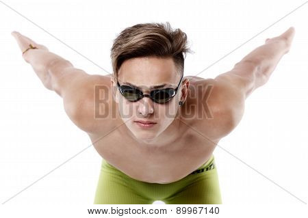 Profile of young , caucasian athlete swimmer with goggles in start position
