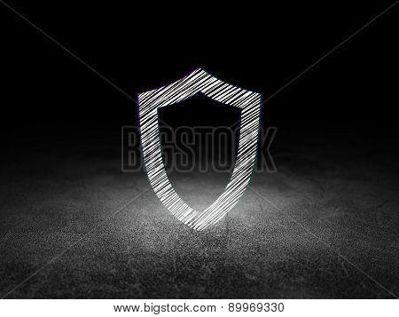 Privacy concept: Contoured Shield in grunge dark room