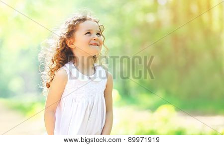 Portrait Of Charming Curly Little Girl Enjoying Summer Sunny Day, Nature Background