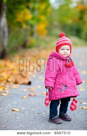 Toddler Girl Outdoors On Autumn Day