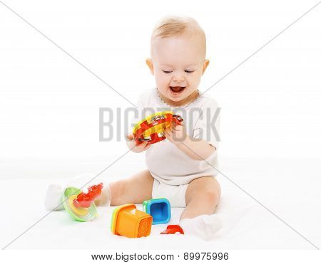 Cheerful Baby In Diapers Playing With Toys