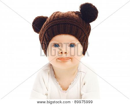 Close-up Portrait Of Funny Baby In Brown Knitted Hat