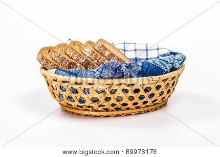 isolated basket of bread from wheat flour. Cut into pieces.