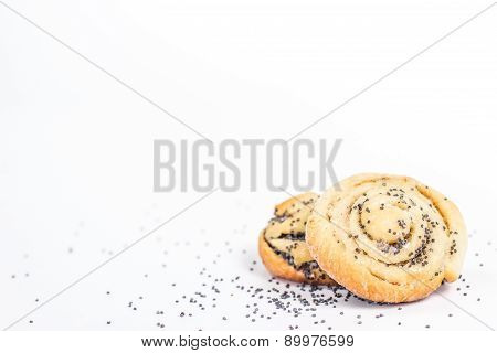 two sweet buns with poppy and poppy seeds. isolated.