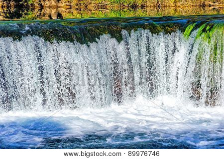 Small Stream And Waterfall In The Preserved Nature