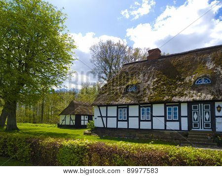 old rustic countryside farmhouse with thatched roof