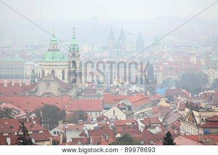 Saint Nicholas Church in Mala Strana and the Tyn Church in Old Town Square viewed from Petrin Hill in Prague, Czech Republic.