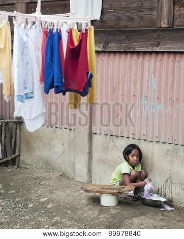 Girl Washing Clothes