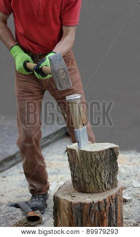 Woodworking Man With A Splitting Wedge