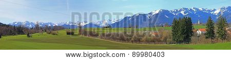 Wide View Of Bavarian Rural Landscape And Alps