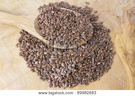Flax Seeds With A Wooden Spoon