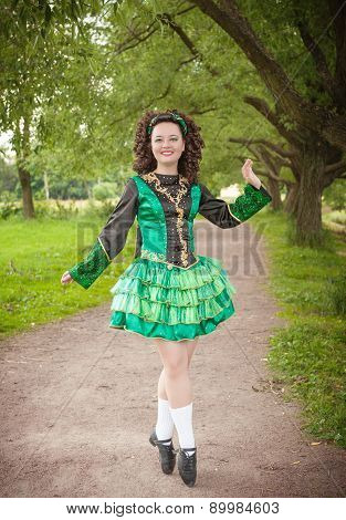 Young Beautiful Girl In Irish Dance Dress Posing Outdoor