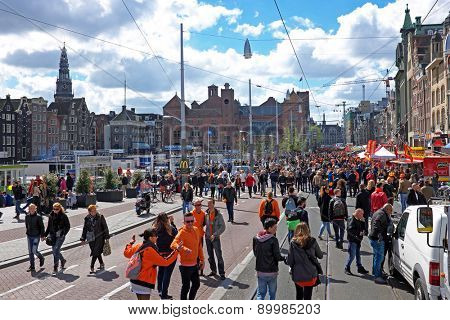 APRIL 27: Amsterdam at the Damrak during the celebration of kings day, april 27, 2015 in Amsterdam, The Netherlands