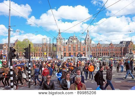 APRIL 27: Amsterdam at the Central Station during the celebration of kings day, april 27, 2015 in Amsterdam, The Netherlands