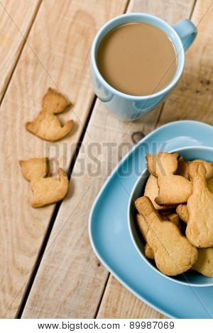 Sweet Tasty Cookies In The Blue Plate, A Cup Of Coffee With Milk And Notebook