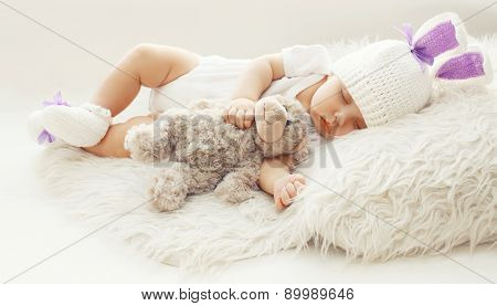 Baby Comfort! Sweet Infant At Home Sleeping With Teddy Bear On The Fur