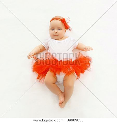 Cute Little Baby Girl Lying In The Red Skirt, Top View