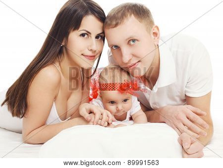 Portrait Of Happy Young Family On A White Background