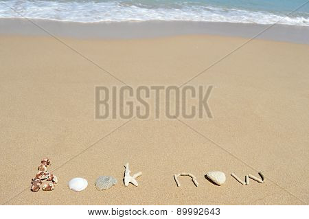 Text 'book Now' In The Sand