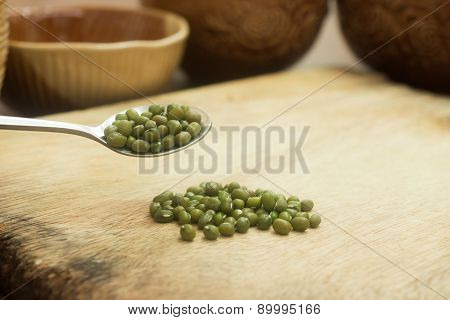 Mung Beans on the Wooden Cutting Board