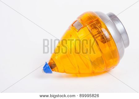 Gyroscopes/ Spinning Top On White Paper Background