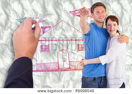 Couple holding keys to home against crumpled white page