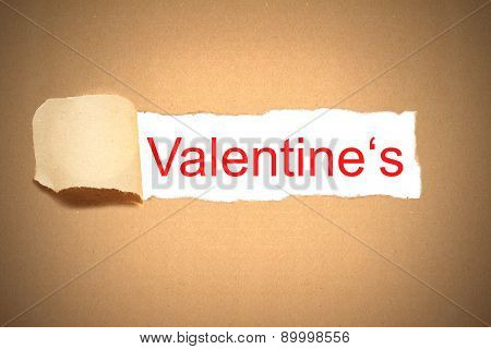 paper envelope torn to reveal valentine's day