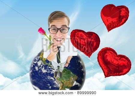 Geeky hipster holding a red rose against blue sky