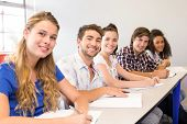 image of students classroom  - Portrait of students writing notes in classroom - JPG