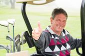 pic of buggy  - Happy golfer driving his golf buggy smiling at camera on a foggy day at the golf course - JPG