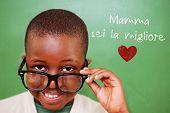 image of tilt  - Cute pupil tilting glasses against green - JPG
