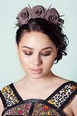 pic of brunete  - portrait of a girl brunete with hair beam with a delicate make up and a wreath in her hair from black roses with thorns rock - JPG