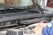 picture of car repair shop  - auto mechanic is working on engine in car repair shop  - JPG