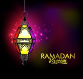 stock photo of kareem  - Beautiful Elegant Ramadan Kareem Lantern or Fanous Hanging With Colorful Lights in Night Background for the Holy Month Occasion of fasting - JPG