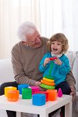 picture of grandpa  - Grandpa and kindergartner playing with color toys - JPG