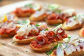 stock photo of piquillo pepper  - Tapas with fish on the Crusty Bread  - JPG